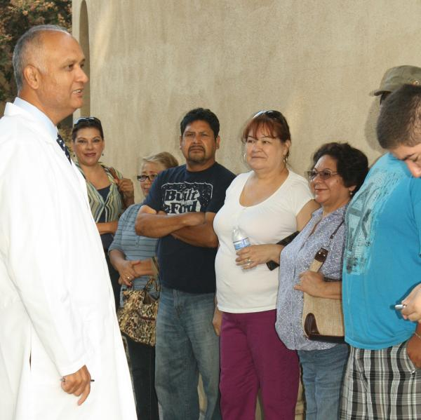 Senator Meets with Residents Waiting for Free Vision Exams and Glasses